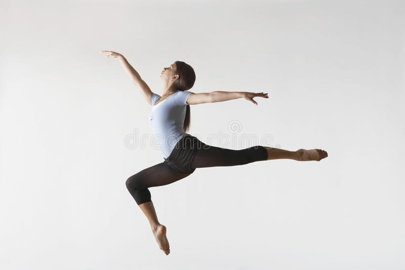 Female Ballet Dancer Leaping In Mid Air royalty free stock photos