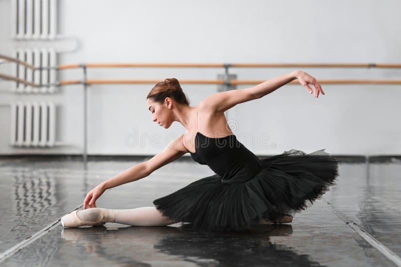 Female ballet dancer posin on rehearsal. Female ballet dancer posing on rehearsal in class. Ballerina dance stock photos