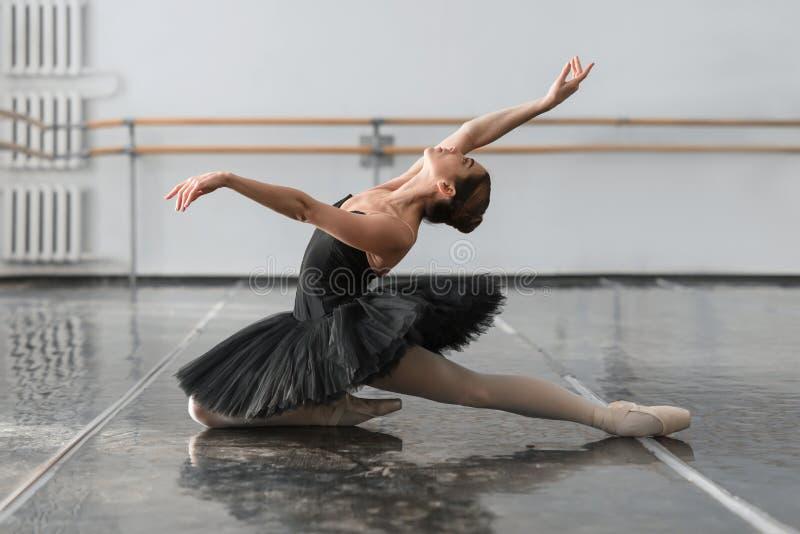 Female ballet dancer posin on rehearsal. Female ballet dancer posing on rehearsal in class. Ballerina dance royalty free stock photos
