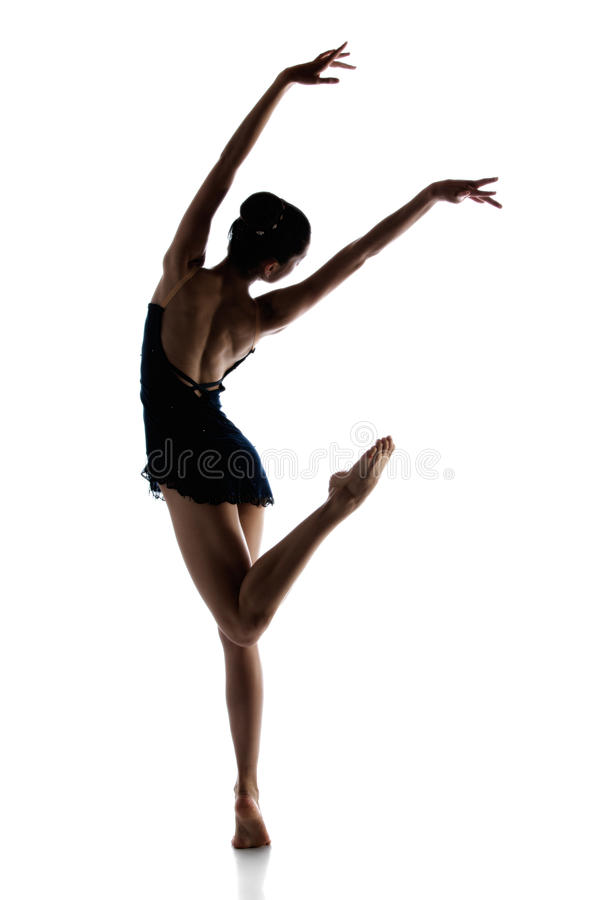 Female ballet dancer. Silhouette of a beautiful female ballet dancer isolated on a white background. Ballerina is barefoot and wearing a dark leotard and short