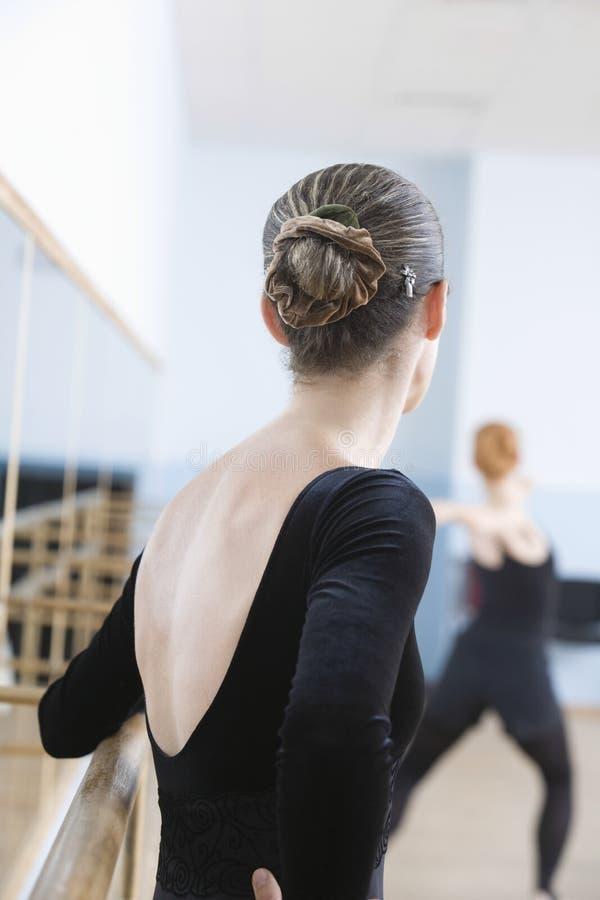 Female Ballet Dancer Standing By Handrail stock photos