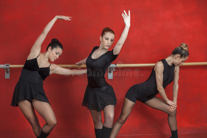 Female Ballet Dancers Performing At Barre stock photo
