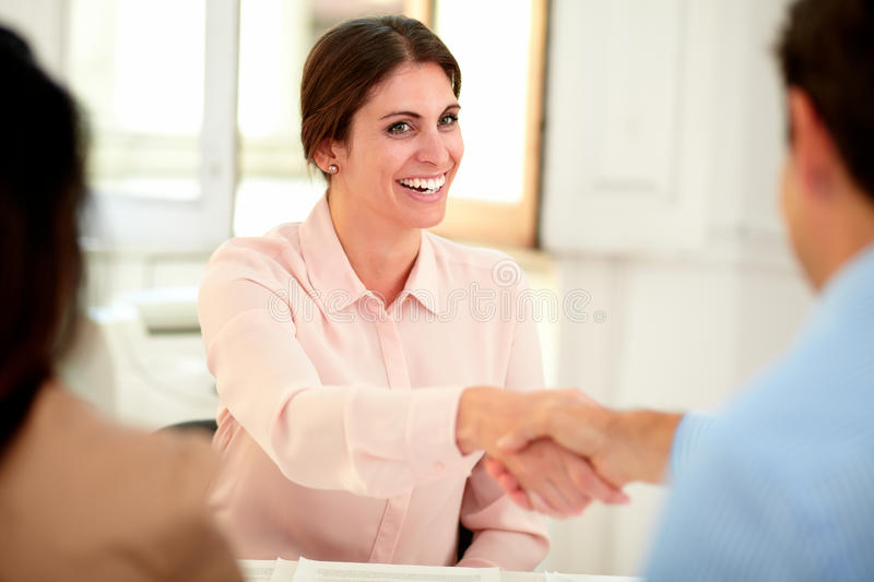 Female bank manager giving a hand greeting royalty free stock photography
