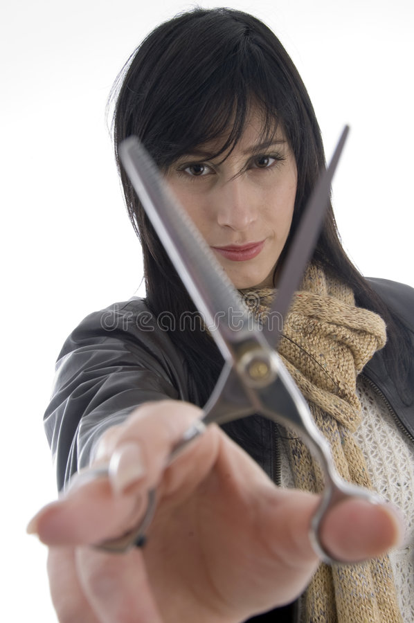 Female barber holding scissors royalty free stock images