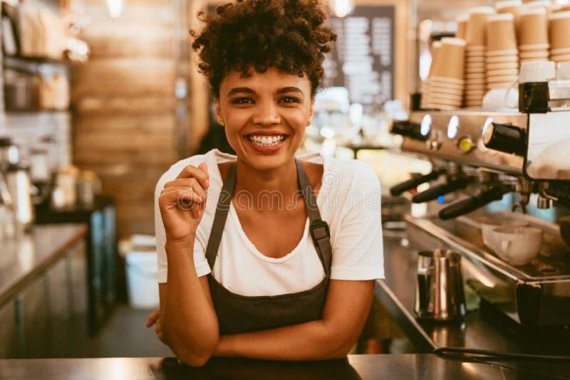 Female barista behind counter stock photos