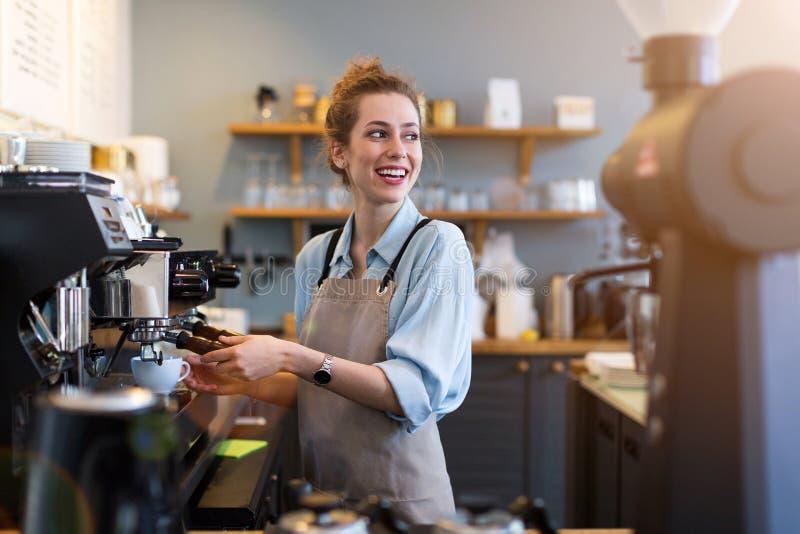 Female barista making coffee stock photography