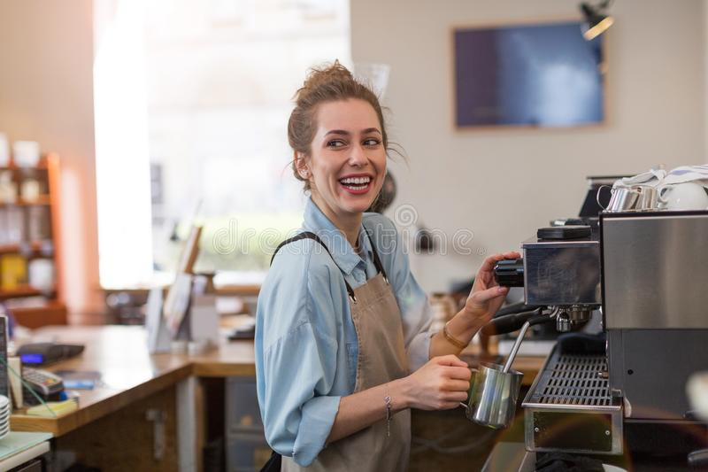 Female barista making coffee royalty free stock photography