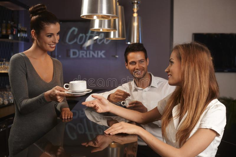 Download Female Bartender Serving Young Couple In Bar Stock Image - Image: 35810433