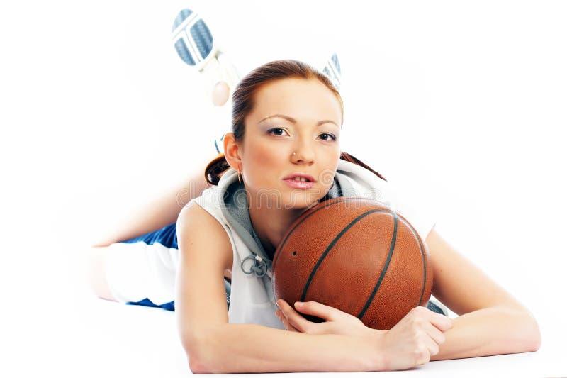 Female basket ball player. Young beautiful female basket ball player royalty free stock photo