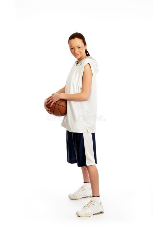 Female basket ball player. Young beautiful female basket ball player royalty free stock photos