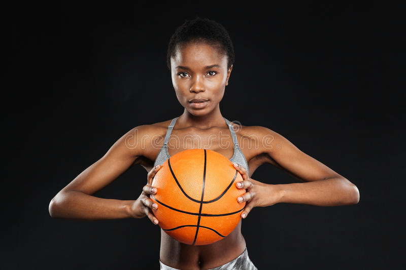 Female basketball player isolated over a black background royalty free stock image