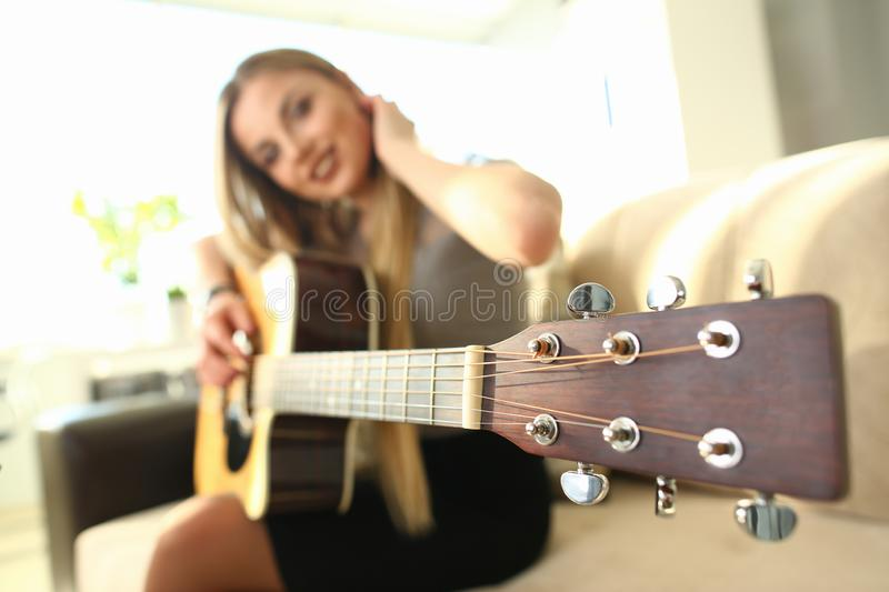 Female Bass Guitarist Performing Music at Home stock photo