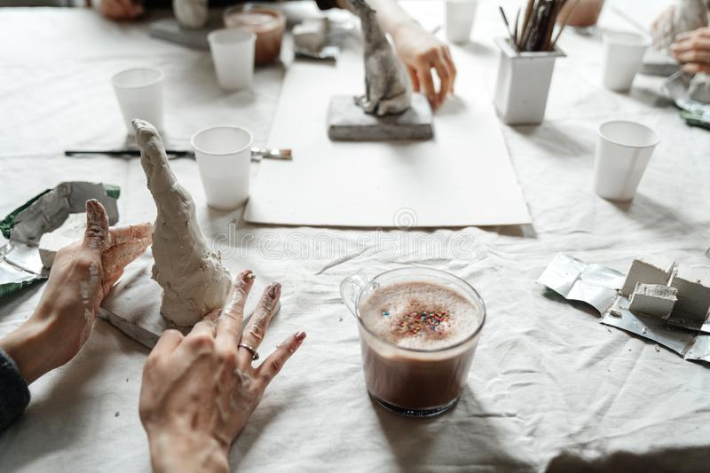 Female beautiful hands mold form in the class for the production of clay things. royalty free stock photos