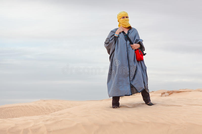 Female In Bedouin Clothes On Dune Royalty Free Stock Image