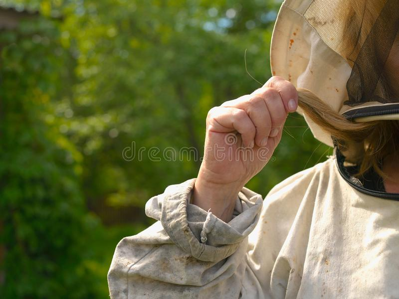 Female beekeeper in protective suit stock photography