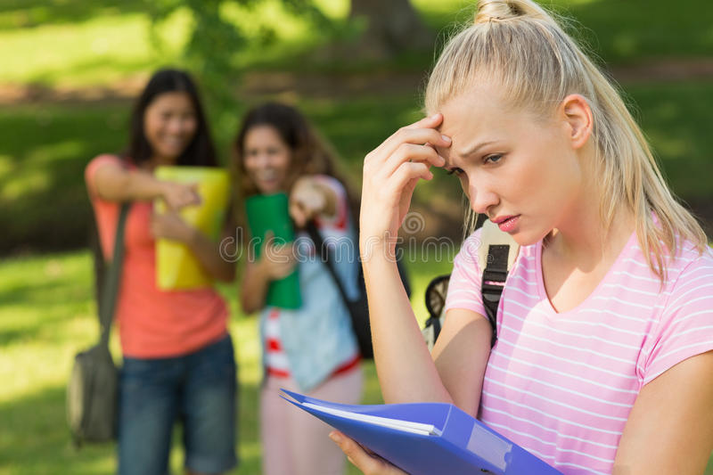 Female being bullied by group of students stock photography