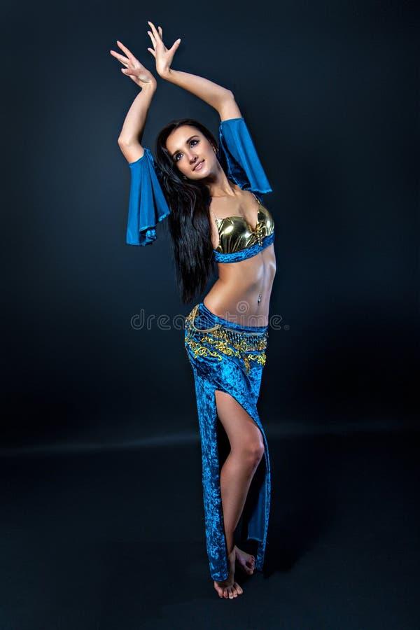 Female belly dancer. Shaking her hips stock images