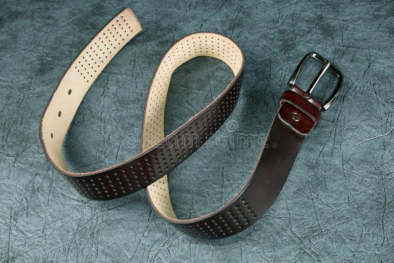 Female belt against from a leather. Female belt against from a grey leather stock photo