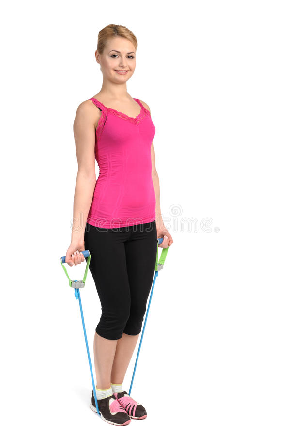 Female biceps exercise using rubber resistance band royalty free stock images