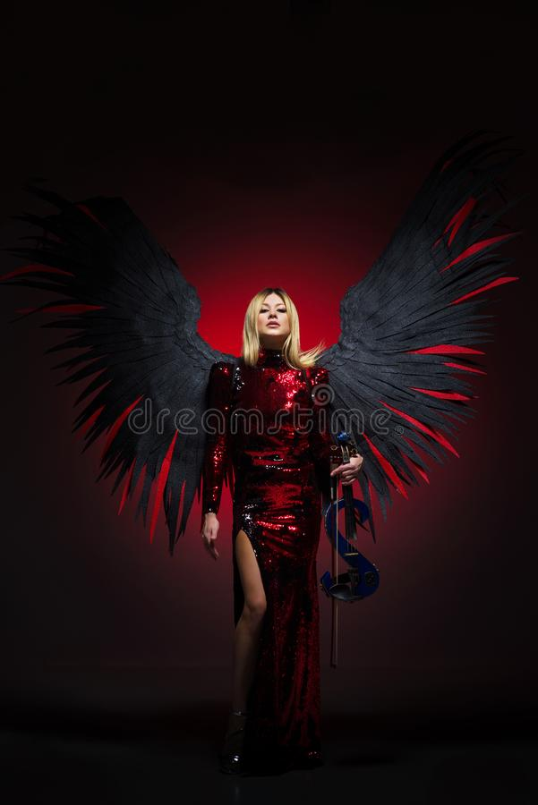 Female with big angel wings on black background. royalty free stock photography