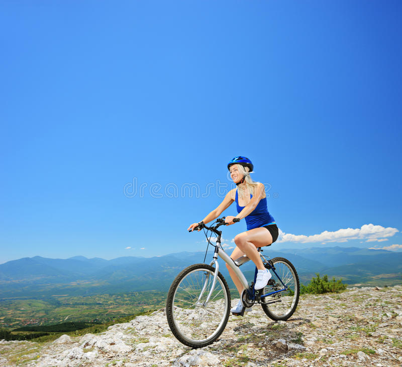 A female biker biking a mountain bike stock photography