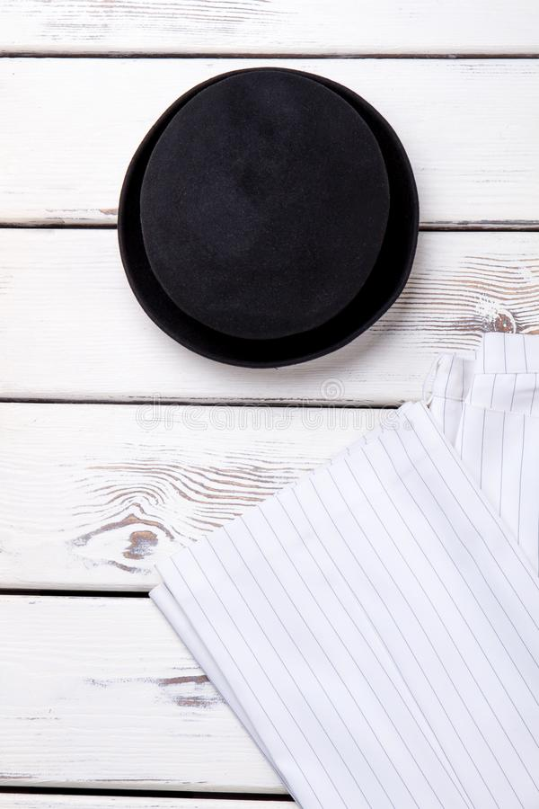 Female black hat and white trousers. royalty free stock photo