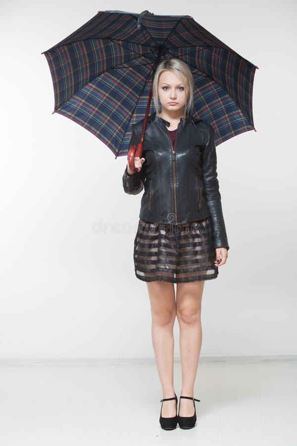 Female with black umbrella, full length, white background royalty free stock photos