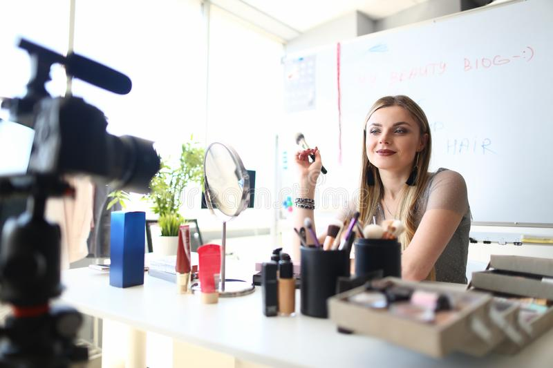Female Blogger Filming Makeup Beauty Tutorial royalty free stock photography