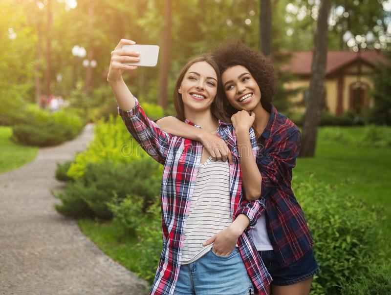 Female bloggers taking picture for publication on webpage stock images