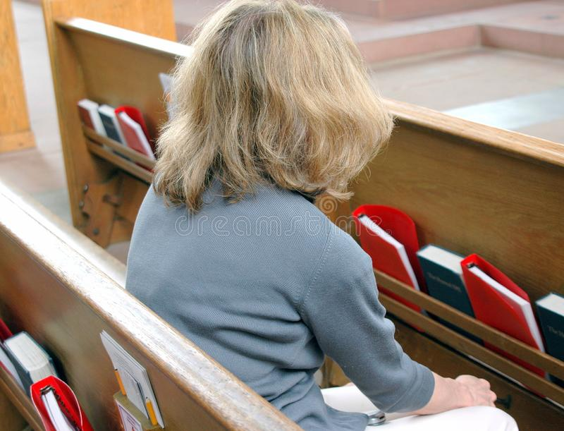Female blond beauty in church. stock image