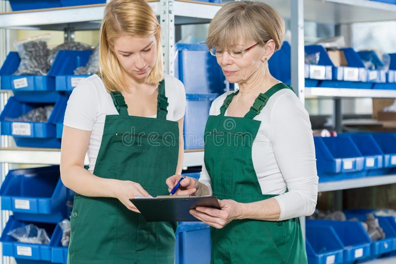 Female blue-collar workers royalty free stock photos