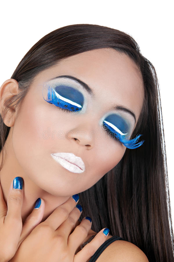 Female with blue and white makeup stock images