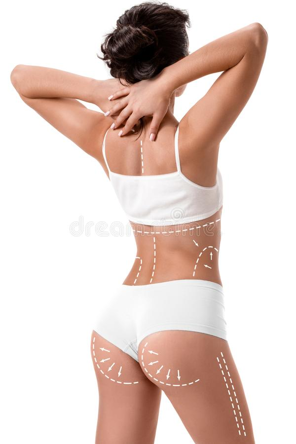 Female body with the drawing arrows on it isolated on white. Fat lose, liposuction and cellulite removal concept. Plastic surgery stock photo