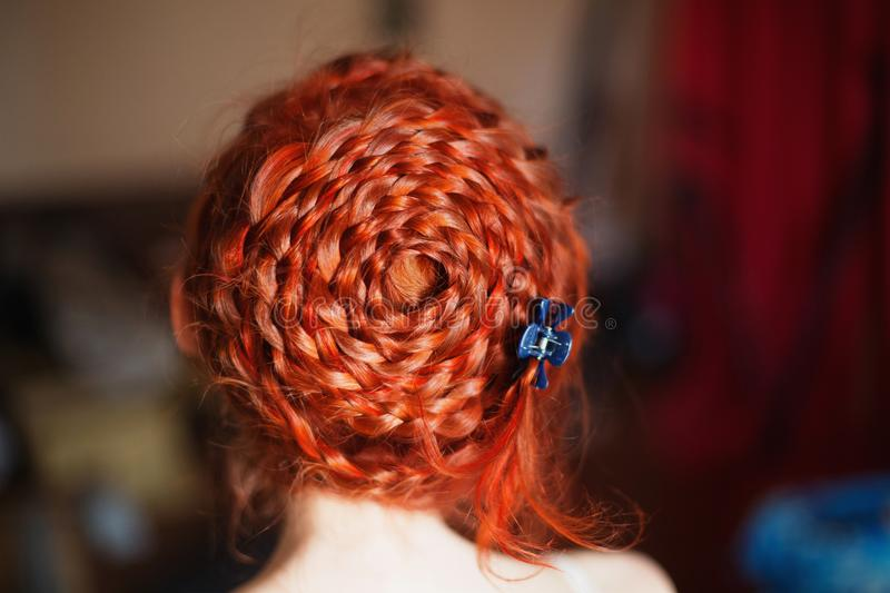 Female body parts close-up. A woman with red curly hair braided in a braid in a white dress. Red-haired girl with pale skin. Pin-up girl makeup. Dutch braid stock photography