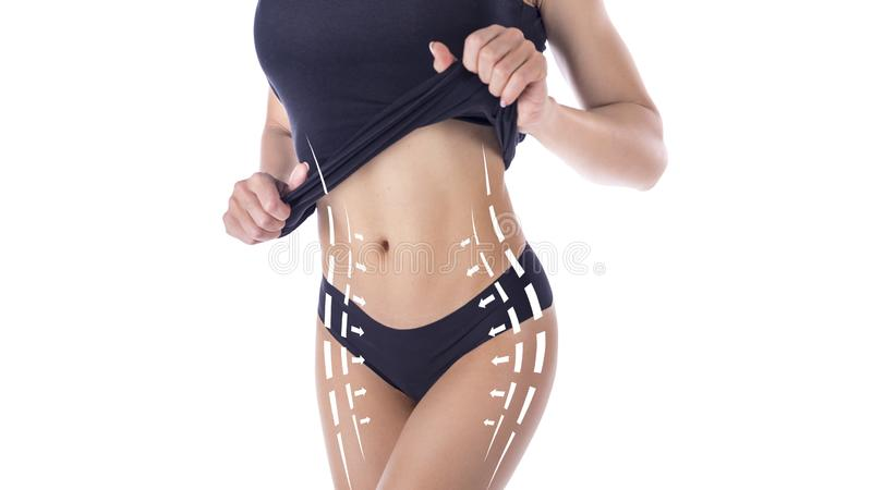 Female body in white slimming underwear with arrows isolated on white baskground. royalty free stock photography