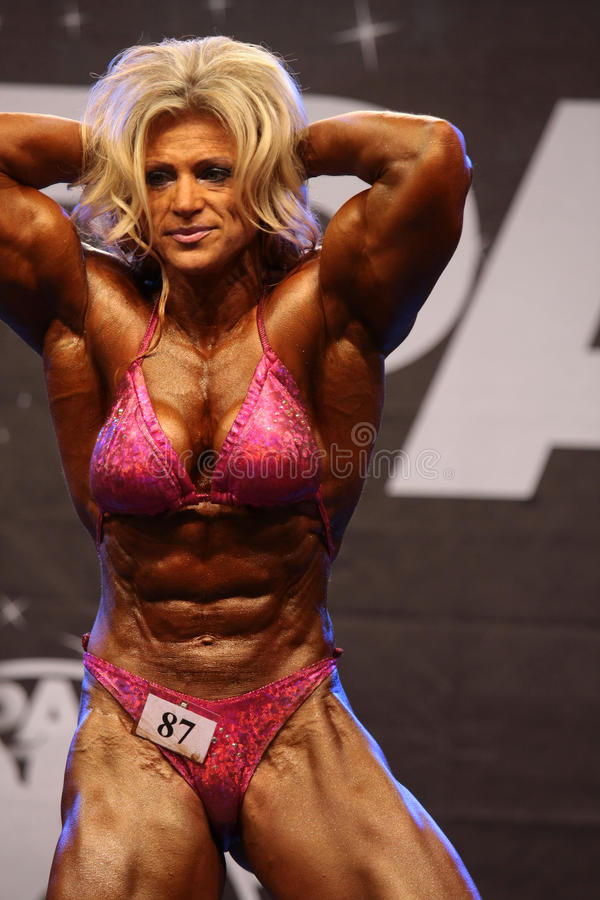 Female bodybuilder editorial photography. Image of
