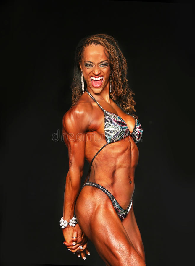 Free Female Bodybuilder Roars Into Middle Age Stock Images - 76593084