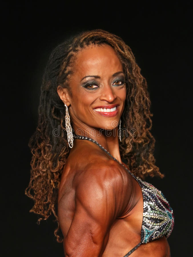 Free Female Bodybuilder Roars Into Middle Age Stock Image - 76593091