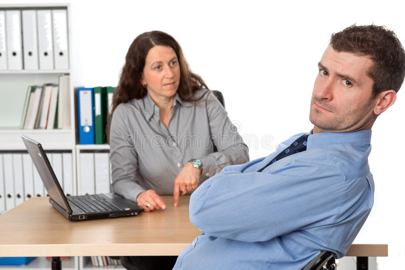 Female boss is angry. Female boss instructing issue for her assistant royalty free stock photo