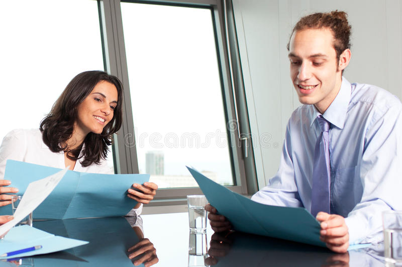 Female boss helping an intern stock photography