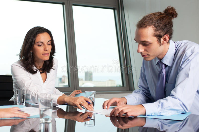 Female boss helping an intern stock images