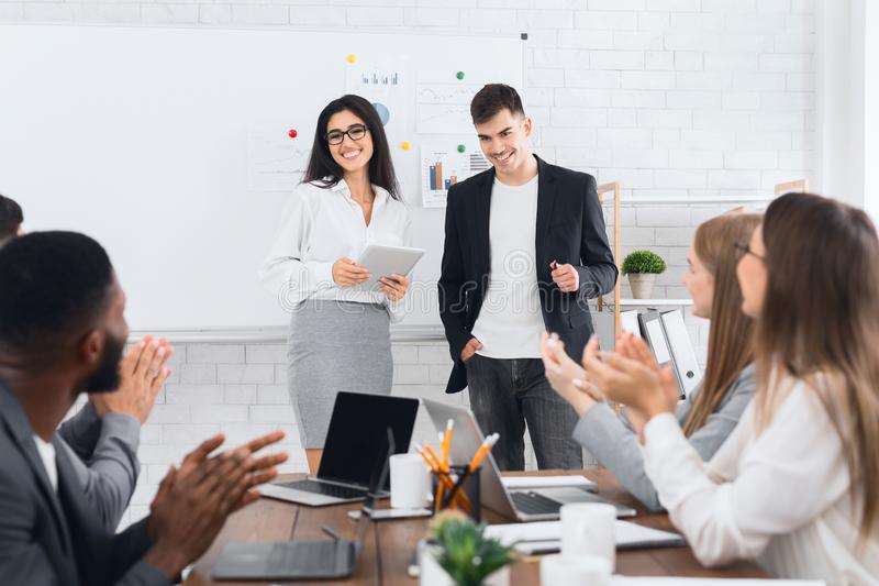 CEO woman introducing new hire employee to office workers royalty free stock images