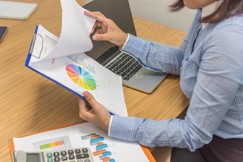 Female boss reading sales reports royalty free stock photos