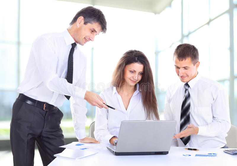 Female boss talking to business team stock photography