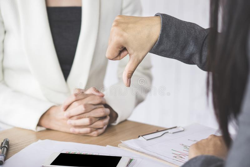 Female boss unhappy and disappointed with the project showing hand dislike to the team royalty free stock photo