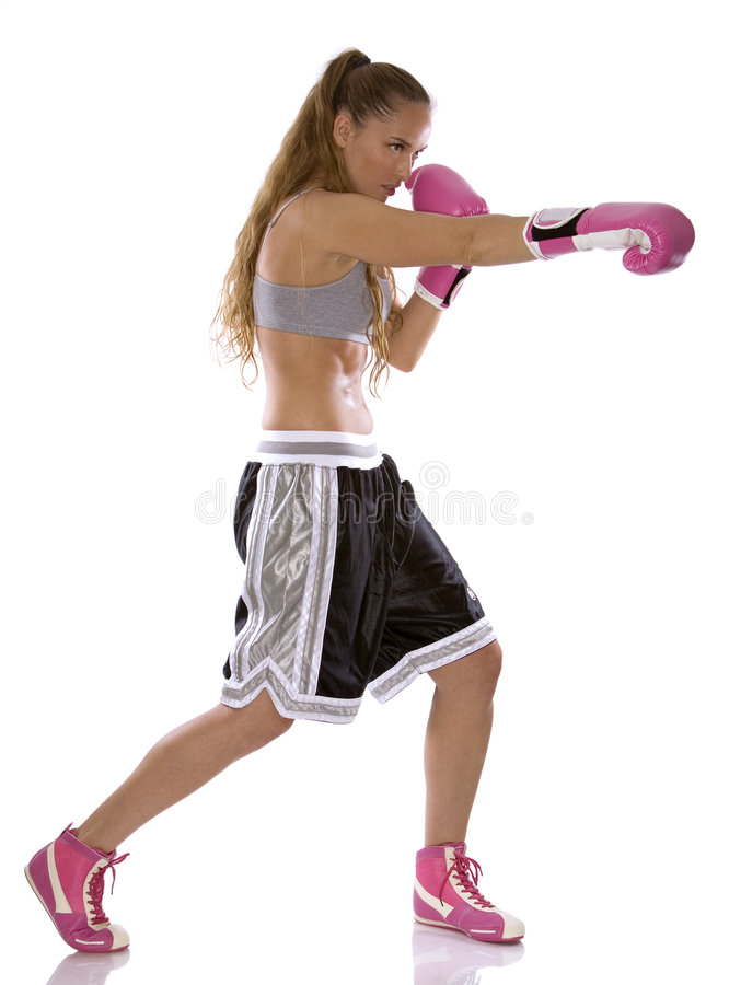 Female boxer. Active woman female boxer jumping high on white background stock photography