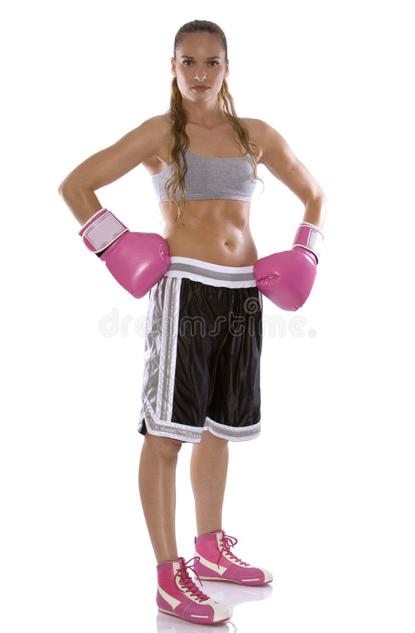 Female boxer. Active woman female boxer jumping high on white background stock photos