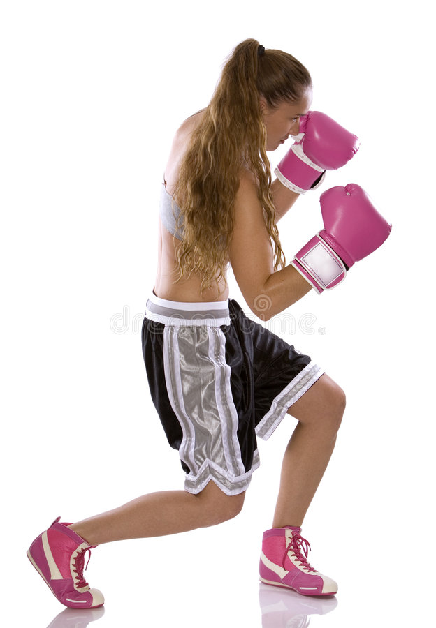 Female boxer. Active woman female boxer jumping high on white background royalty free stock photos