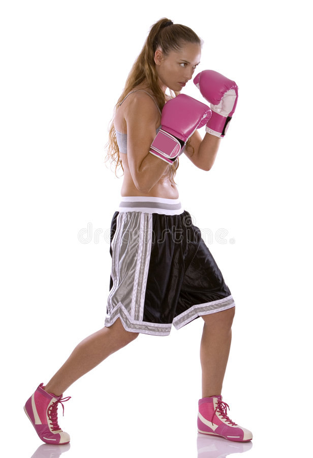 Female boxer. Active woman female boxer jumping high on white background royalty free stock photo