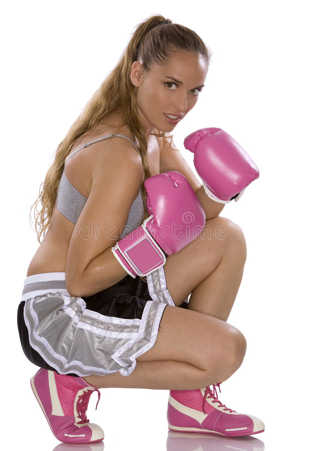 Female boxer. Active woman female boxer jumping high on white background stock photo